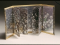"11.. Memory of a Mirrored : Book I ,opened , 11 x 22""."